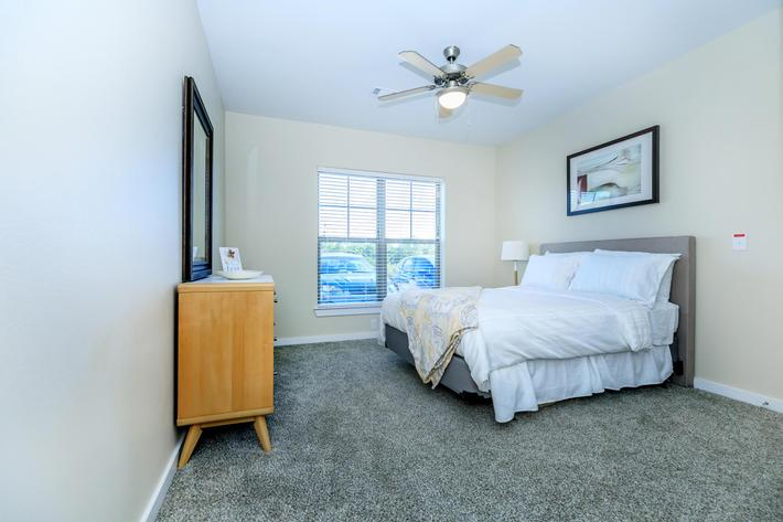Apartments in Leander - Hills at Leander Spacious Bedroom with an Expansive Closet, Plush Carpeting, and Many More Great Amenities