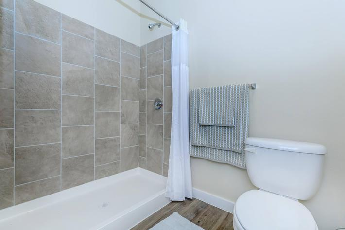 Apartments in Leander TX - Hills at Leander Expansive Bathroom with a Large Vanity, Shower, and Much More