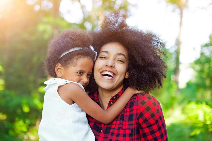 Mother and daughter hugging outdoors iStock-541291826.jpg