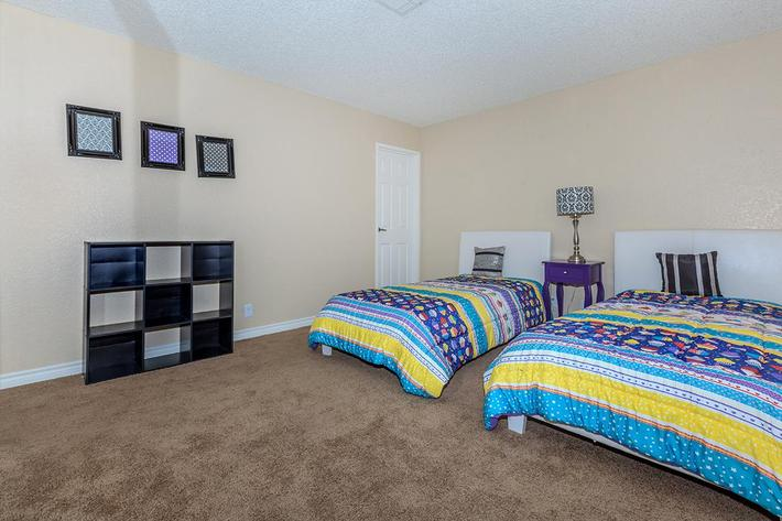COMFORTABLE BEDROOM AT MOUNTAIN VISTA IN LAS VEGAS