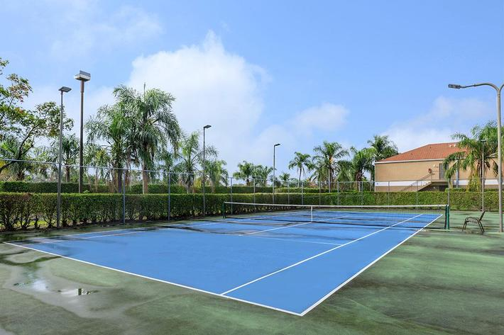 Let out some energy at the tennis court at Belaire Tower Apartments Boca Raton, FL.