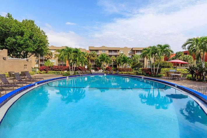 Relax at the shimmering swimming pool at Belaire Tower Apartments Boca Raton, Florida.