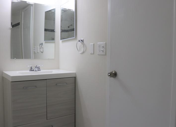 Contemporary bathrooms at Belaire Tower Apartments Boca Raton, Florida.