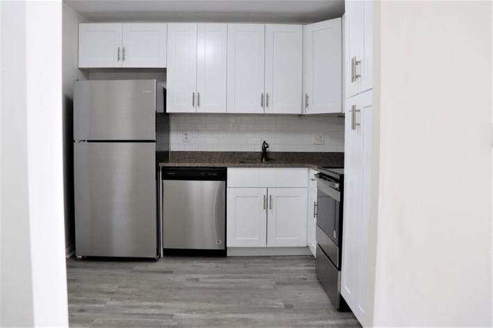 Dishwasher and refrigerator at Belaire Tower Apartments Boca Raton, FL.
