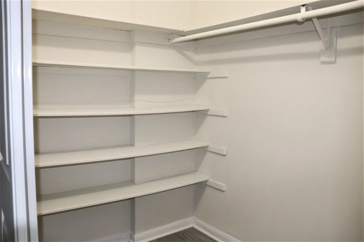 Walk-in closets in the Camino Premium at Belaire Tower Apartments Boca Raton, FL.