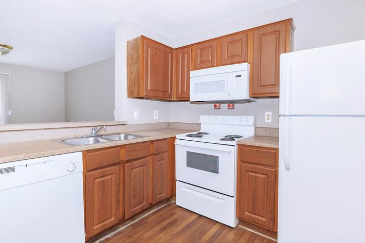 Fully-equipped kitchen in 1 bed 1 bath at Ansley at Harts Road in Jacksonville, Florida