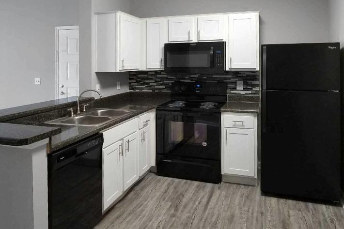 1 bed 1 bath modern kitchen at Ansley at Harts Road in Jacksonville, Florida