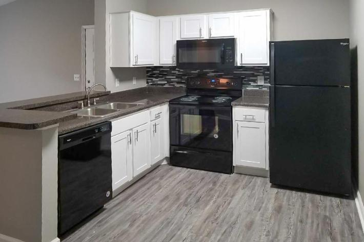Fully-equipped kitchen at Ansley at Harts Road in Jacksonville, Florida