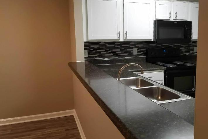 Breakfast bar 3 bed 2 bath at Ansley at Harts Road in Jacksonville, Florida