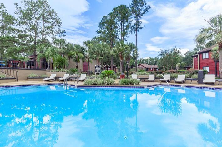 Sit back and relax poolside here at Ansley at Harts Road in Jacksonville, Florida