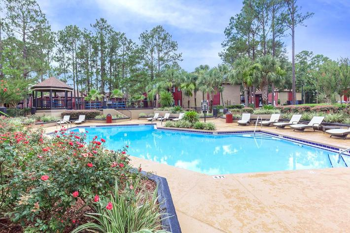Enjoy the shimmering swimming pool here at Ansley at Harts Road in Jacksonville, Florida