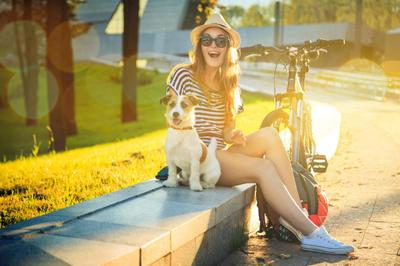 Happy Hipster Girl with her Dog in the City iStock_000056651810_Full.jpg