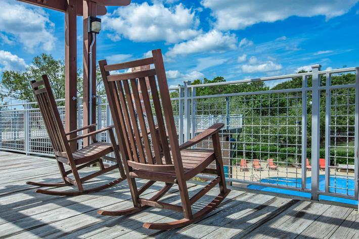 Enjoy the deck overlooking the shimmering swimming pool at South Front In Wilmington, North Carolina.