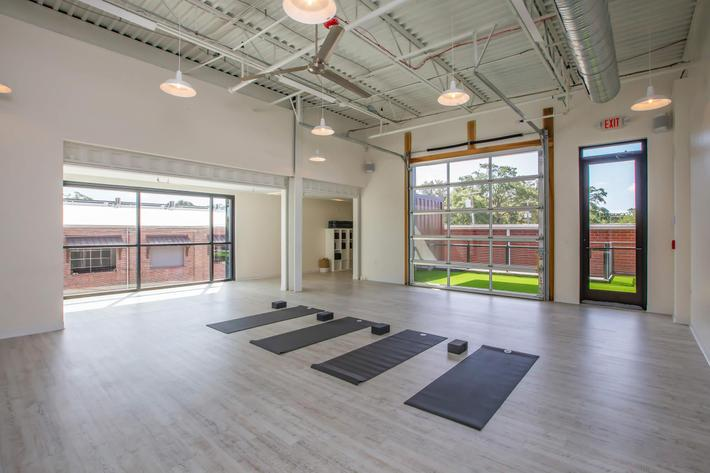 Relax your mind and body with some yoga at South Front In Wilmington, NC.