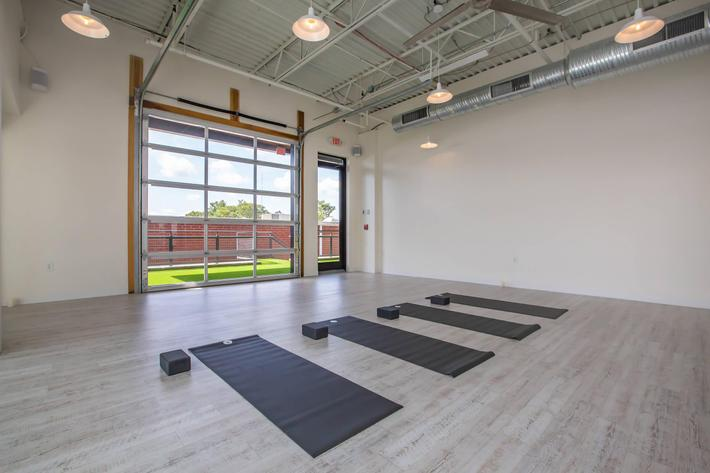 Yoga room at South Front In Wilmington, North Carolina.
