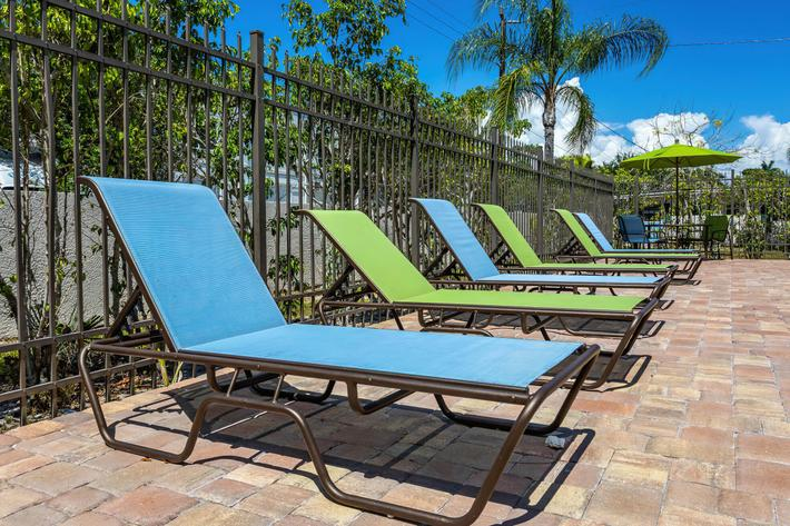 Lounge by the shimmering swimming pool at Wild Pines of Naples