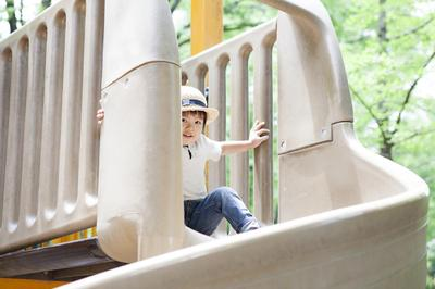 Boy playing slide.jpg