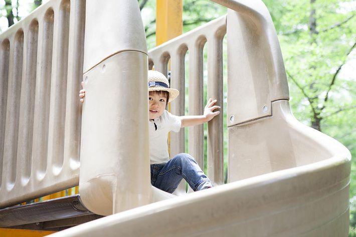 Boy playing slide.jpg