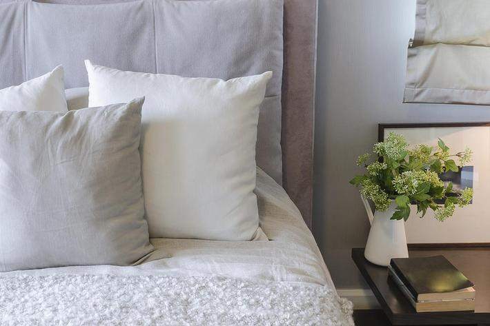 white pillows on white bed.jpg