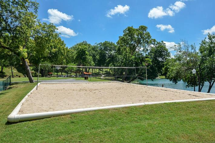 Westshore Colony Apartments in New Braunfels, TX - Sand Volleyball Court 01.jpg