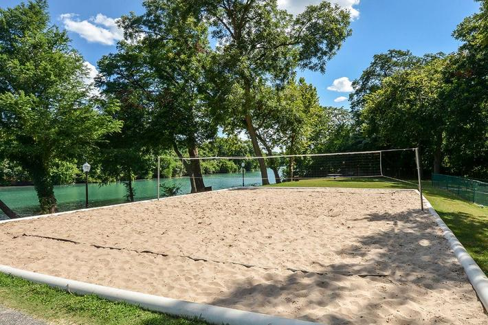 Westshore Colony Apartments in New Braunfels, TX - Sand Volleyball Court 02.jpg