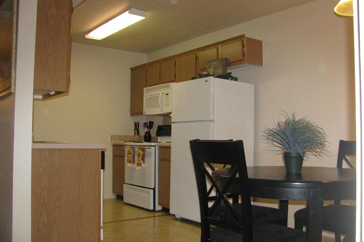 Dining area into kitchen w furniture.JPG