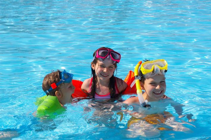 Happy Swimmers in Pool  iStock_000003630145_Large.jpg
