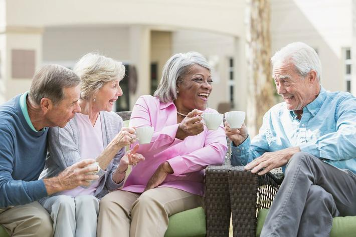senior-friends-outdoors-drinking-coffee-.jpg