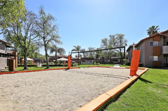 Sand Volleyball Court at The Vue Apartment Homes in San Bernadino, CA