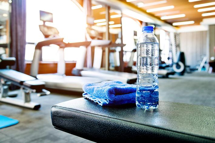 Towel and a bottle of water in gym GettyImages-948875318.jpg