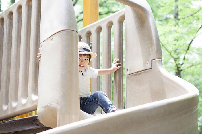 Boy playing on slide.jpg
