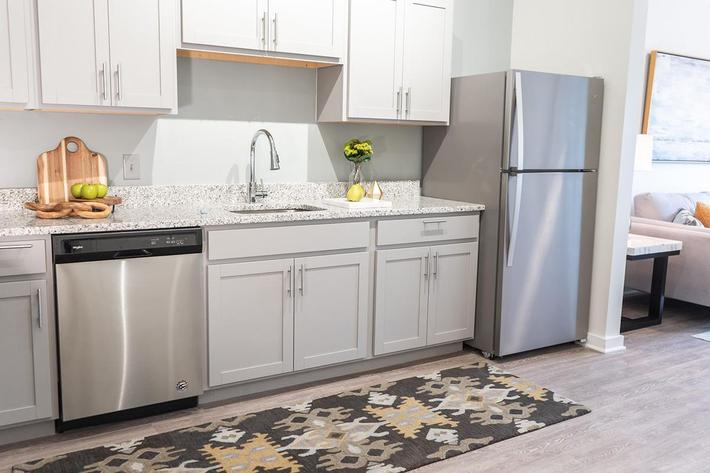 Stainless steel appliances in kitchen of Chelsea floor plan at The Lofts at Brentwood
