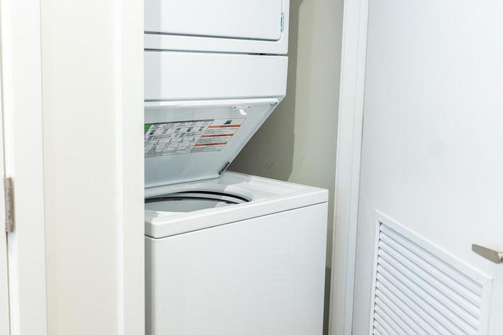 Washer and dryer in studio apartment at The Lofts at Brentwood