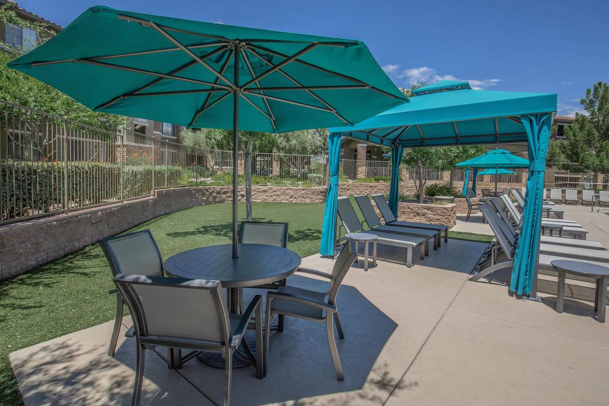 a green lawn chair with an umbrella