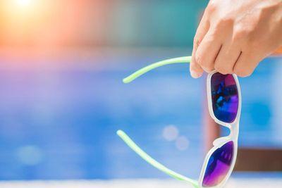 Woman holding sunglasses.jpg