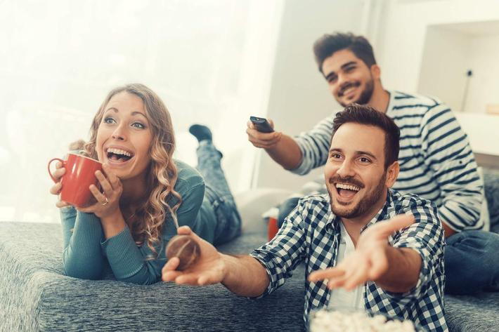 Group of friends watching TV at home iStock-628595216.jpg