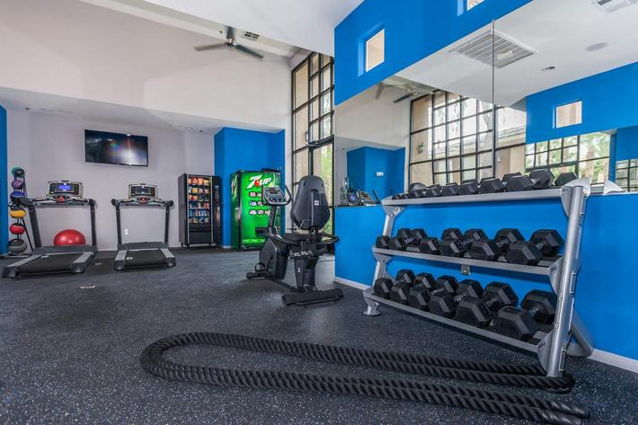 The fitness center at St. Clair Apartments