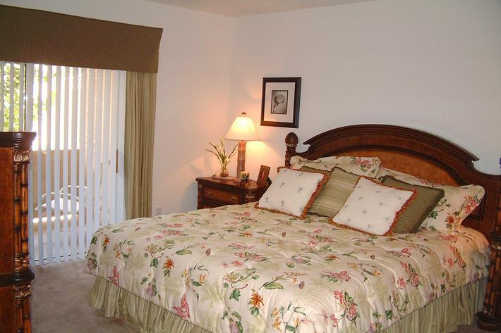 Comfortable bedroom at St. Clair Apartments