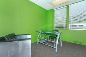 a green chair in a room