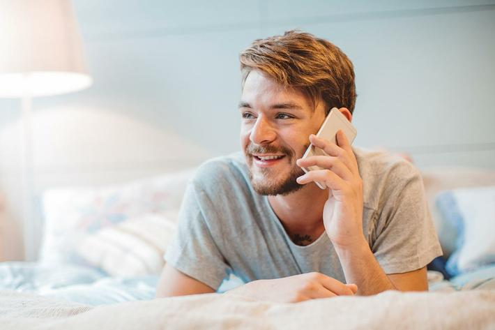 interior-bedroom-man on phone in bed.jpg
