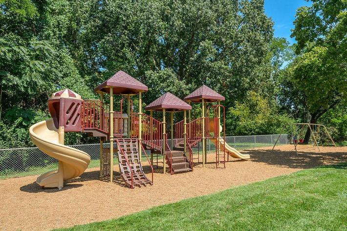 Orchard Village Apartments in Manchester, MO - Playground 02.jpg