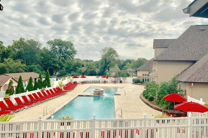 Orchard Village Apartments in Manchester, MO - Swimming Pool.jpg