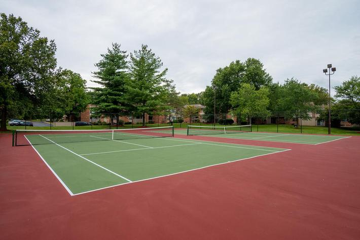 Orchard Village Apartments in Manchester, MO - Tennis Court 01.jpg