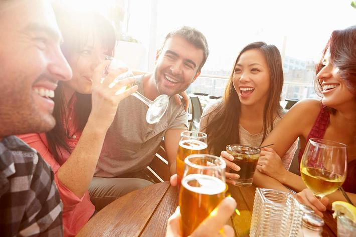Group Of Friends Enjoying Drink At Outdoor Rooftop Bar iStock-478503875.jpg