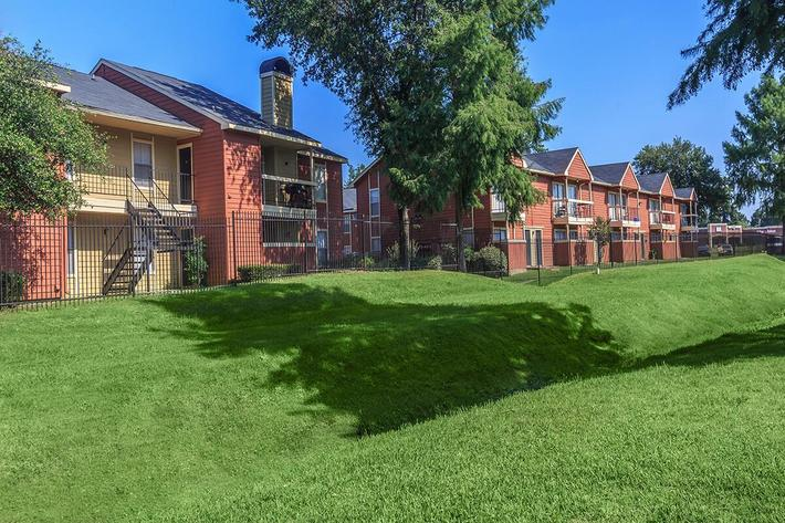 Beautiful green landscaping surrounding The Park at Summerhill Road