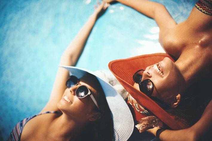 Friends relaxing in the pool in Texarkana, Texas