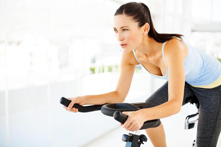 Woman on exercise bicycle