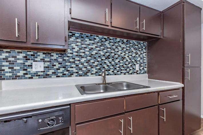 Beautiful tile backsplash in the kitchen at The Park at Summerhill Road