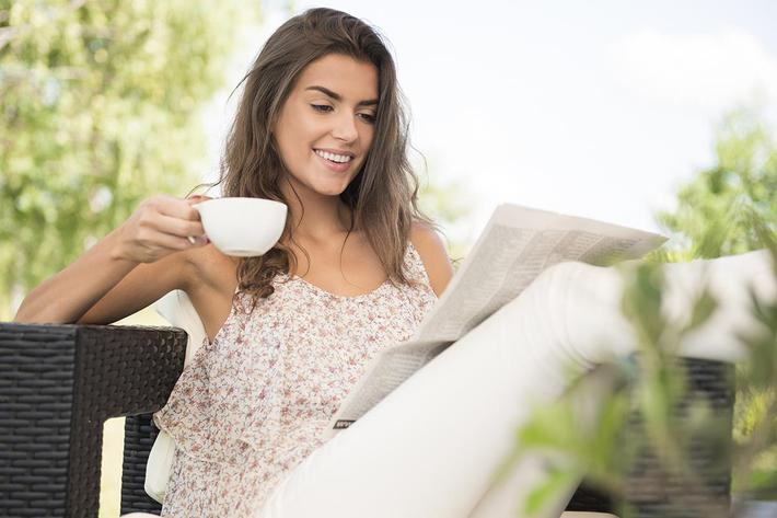 lady drinking coffee outside.jpg