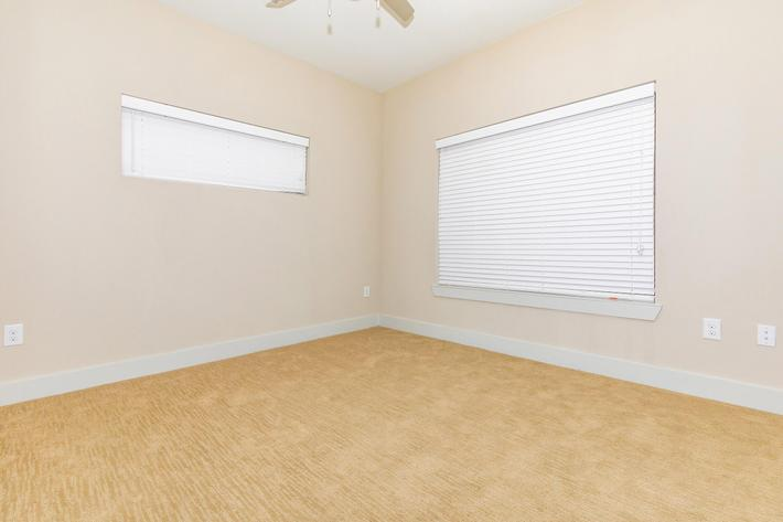 Ceiling Fans and Wall-to-Wall Carpeting in Bedrooms